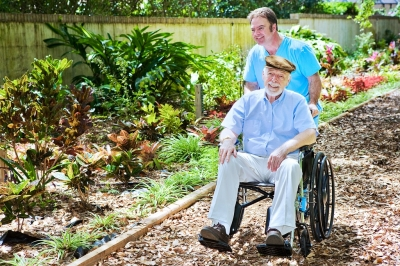 caregiver taking his patient for a walk