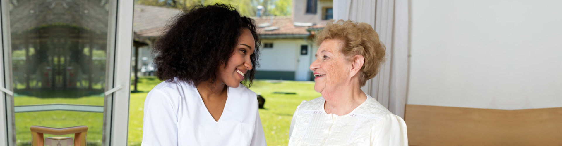 female caregiver and active senior woman talking at each other
