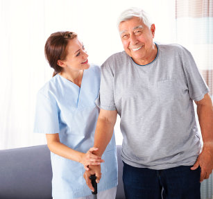 caregiver assisting senior in walking