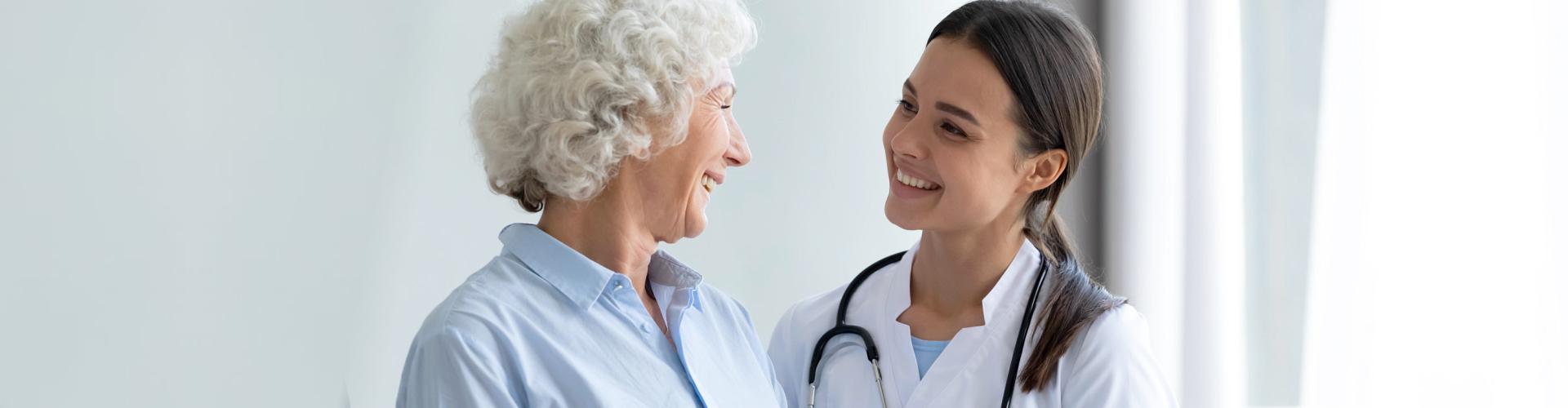 senior woman and nurse talking